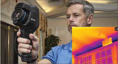An inspector using their FLIR EXX thermal imager inside a home.